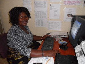 Tisu Howa, our Direct of School & Teacher Training Center, learning how to use the computer & Microsoft Word