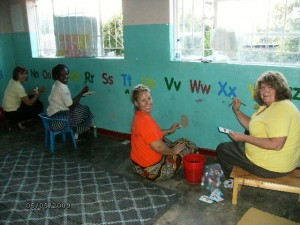 Cindy Dickson and Pam Loomis painting Chifundo III in 2009. These ladies return to Malawi this July 2011. Pegi Scarlet (far rt) Zikomo Pegi!