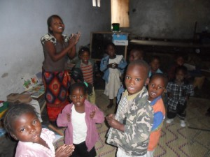 Kids worshipping at Simon's center.  Simon and Yamikani also lead our community Bible outreach events. Zikomo Simon!