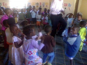Paul Dancing with children at the Community Based Child Care Centers. We work in partnership with these centers to transform them into vibrant learning environments (Head Start Malawi).