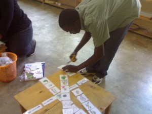 Felix helping teachers from CBCCCs with materials for their centers. Thanks Felix and welcome to our staff! 