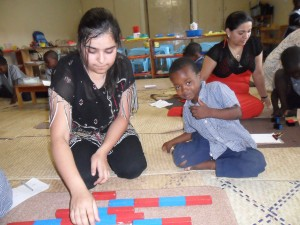 Bhavya working with Wisdom on number rods. 