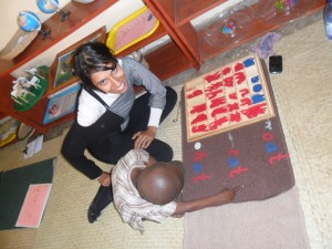 Narzana working with Joshua on his  Montessori Word Building! 